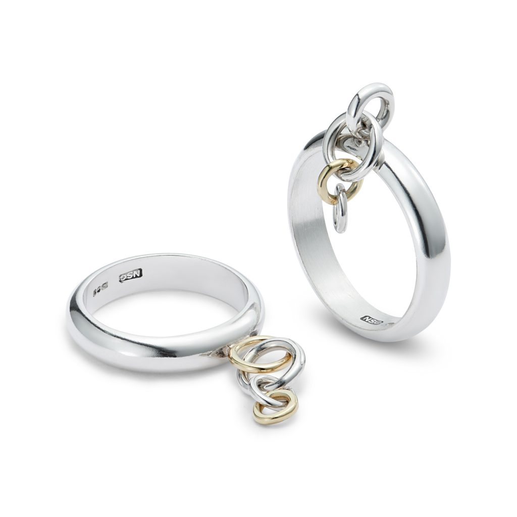 Sterling silver and 18ct yellow gold kinetic rings