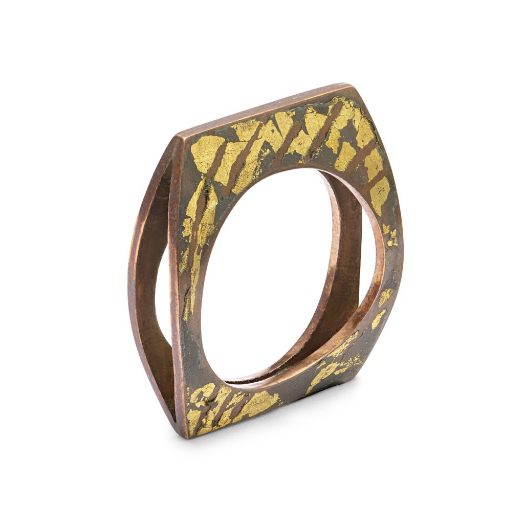 Copper flip ring with gold leaf pattern detail