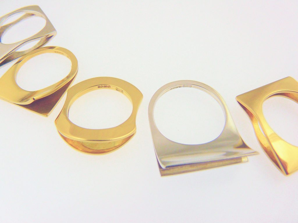 Sterling silver and 18ct yellow gold flip rings, each made from 2 sheets of metal